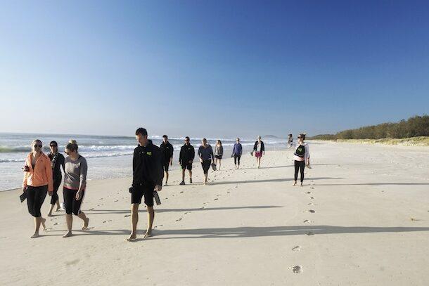 beach walking group shot